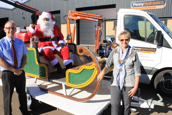 Santa collects his new sleigh from Tim Penny
